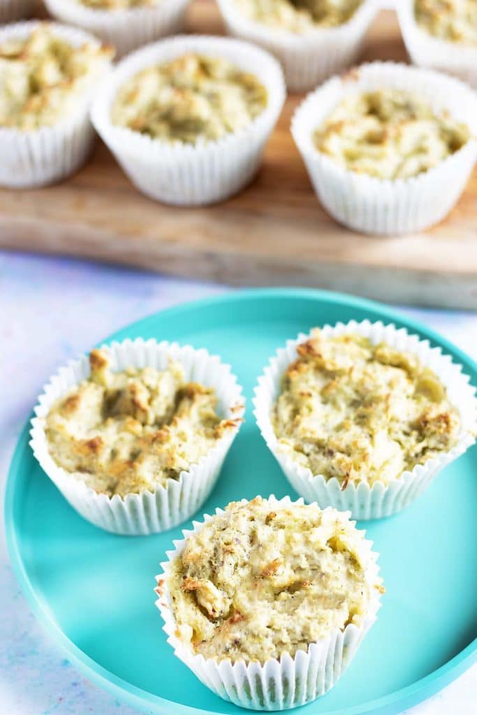 broccoli and cheese muffins on turquoise plate and wooden board