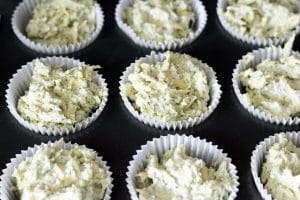 uncooked broccoli muffins in muffin cases