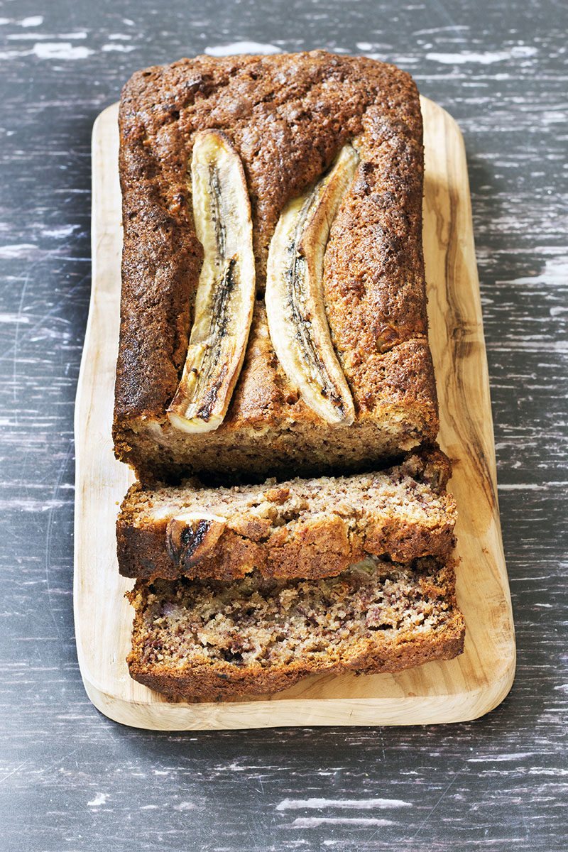 no butter banana bread, sliced, wooden board