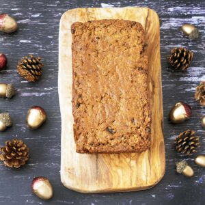 Christmas carrot cake tea loaf on board with xmas table decorations