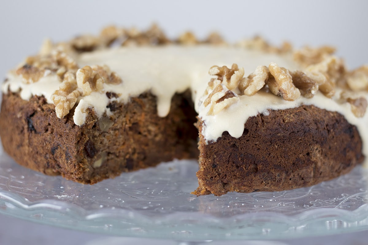 Healthy carrot and date cake with banana. One slice cut. Recipe by Sneaky Veg