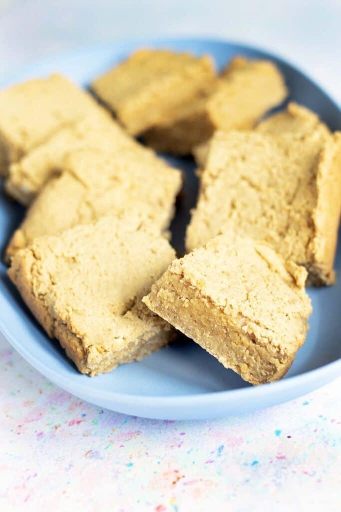 peanut butter chickpea blondies on blue plate