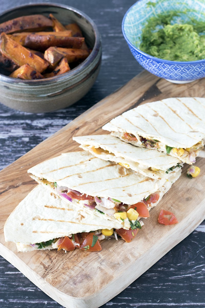 quesadilla on board with sides