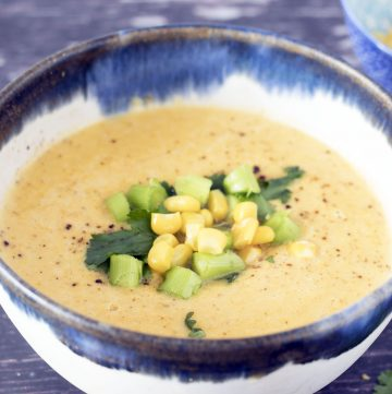 close up of squash and corn soup in bowl