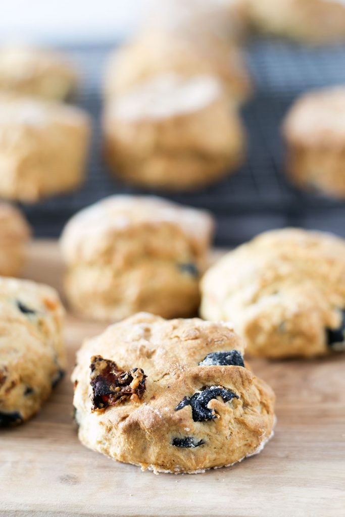savoury scones with sundried tomatoes and olives on board