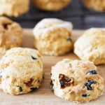 savoury scones with olives and sundried tomatoes on wooden board