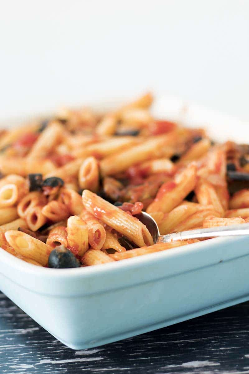 Pasta in blue dish with smoky tomato and aubergine sauce