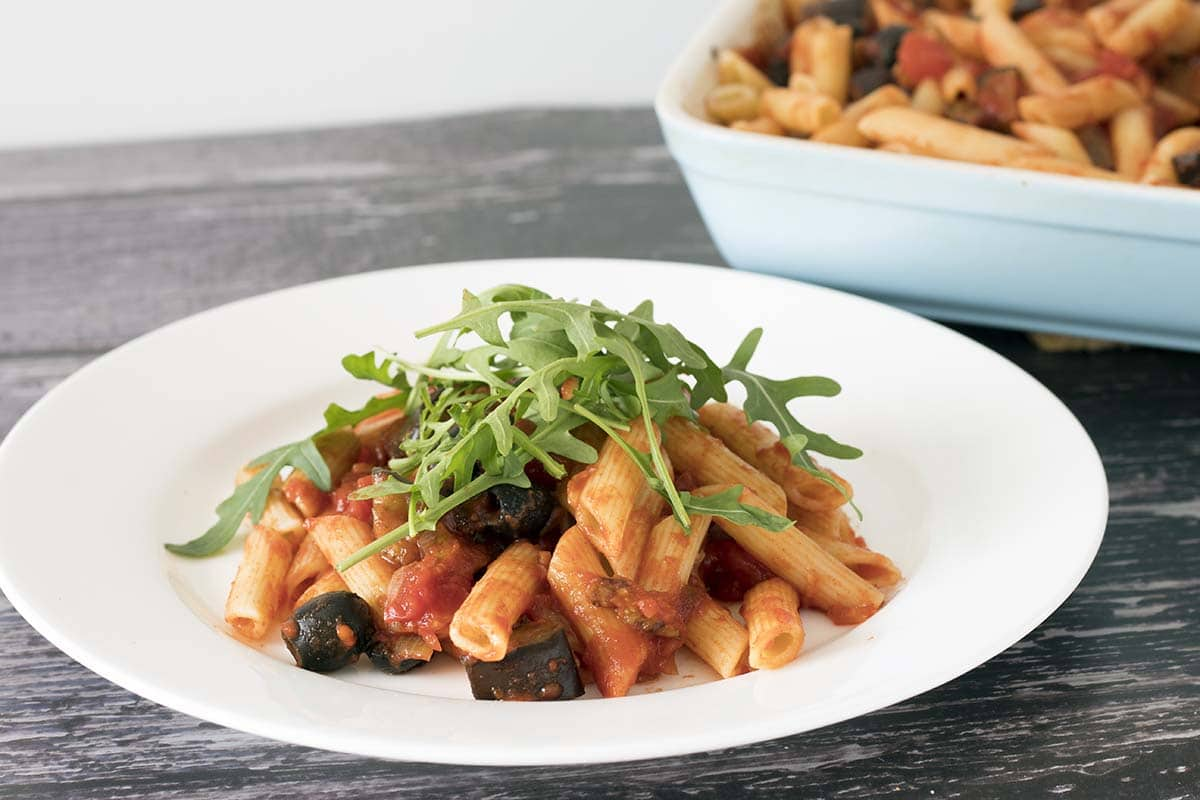 pasta with smoky aubergine and tomato sauce - rocket on top