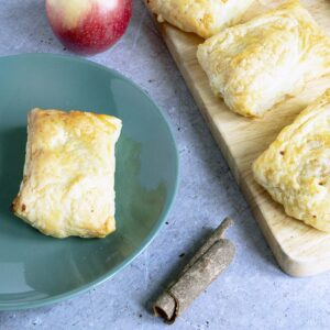 apple turnovers on board and green plate