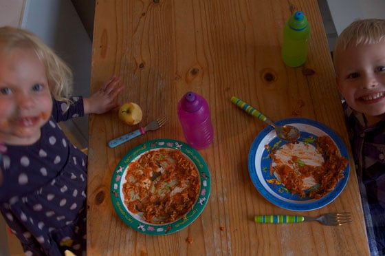 Children eating tomato sauce and pasta sneaky veg photo