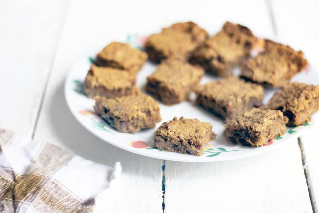 squares of carrot cake bars on plate