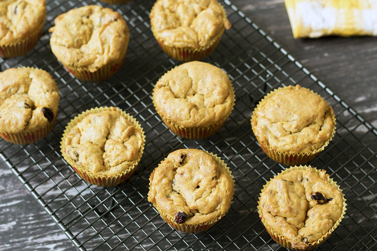 close up of carrot and banana muffins on cooling rack
