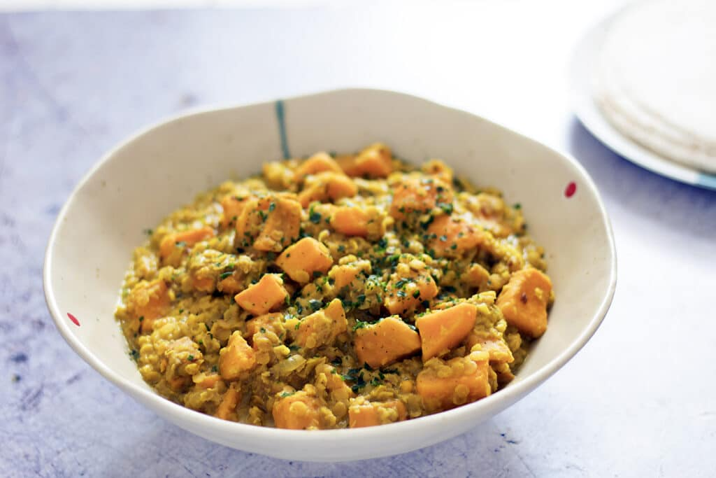 red lentil, sweet potato and coconut curry in bowl