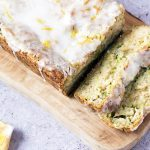 courgette lemon cake sliced on wooden board