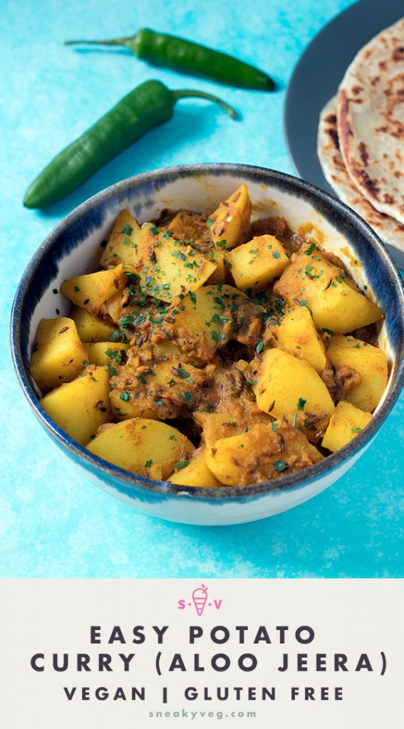 easy potato curry in bowl with parathas and chillies on blue background