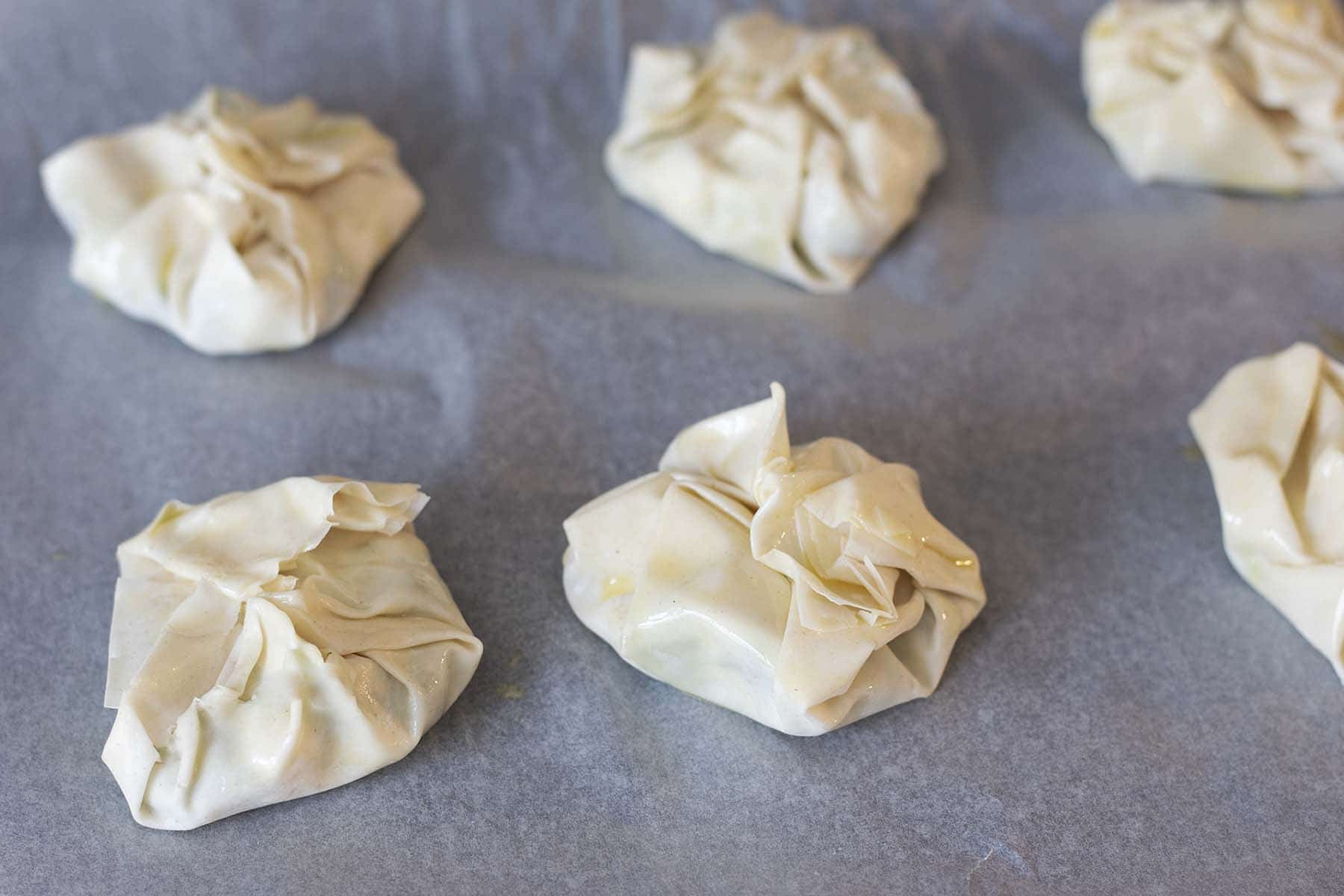 uncooked filo parcels on baking tray