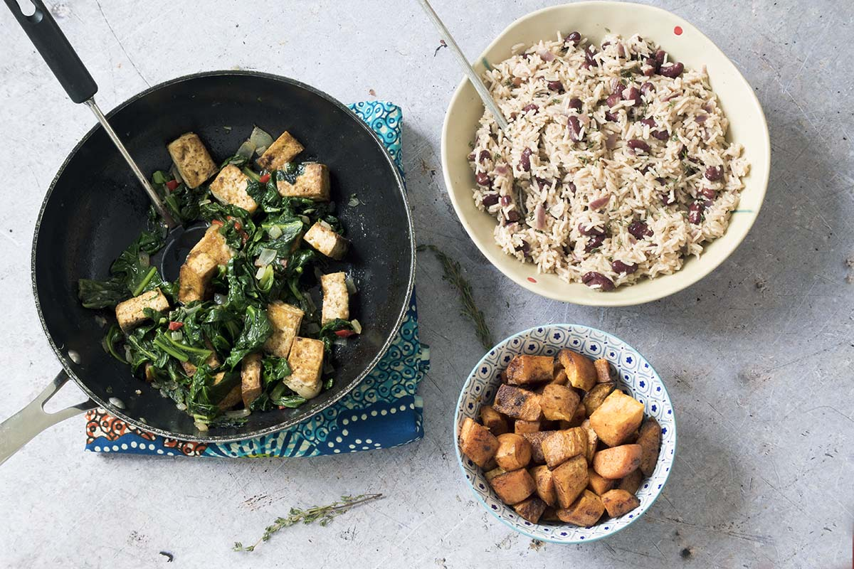 jerk tofu and callaloo or spinach with rice and beans and sweet potatoes