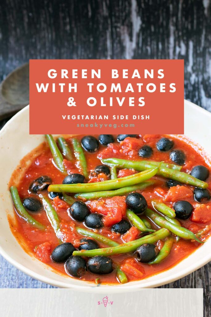 green beans in ceramic bowl with tomato sauce and olives