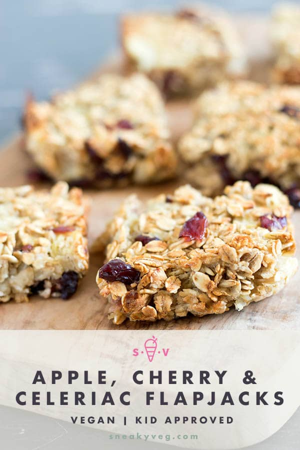 apple, cherry and celeriac flapjacks cut into squares on wooden board