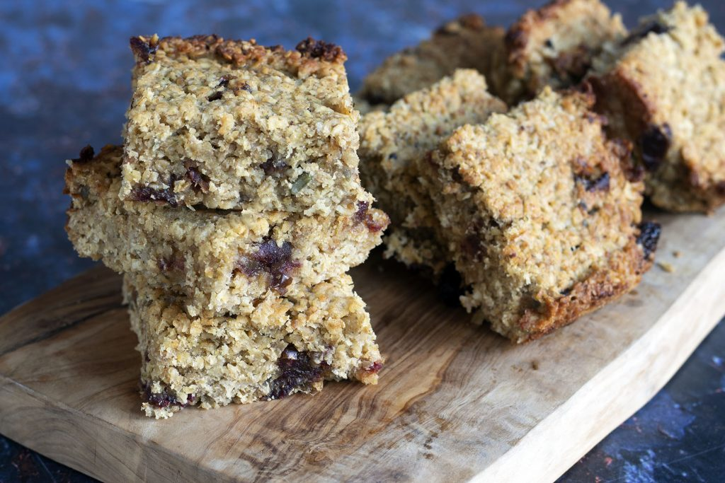 date and apple flapjacks on a wooden board