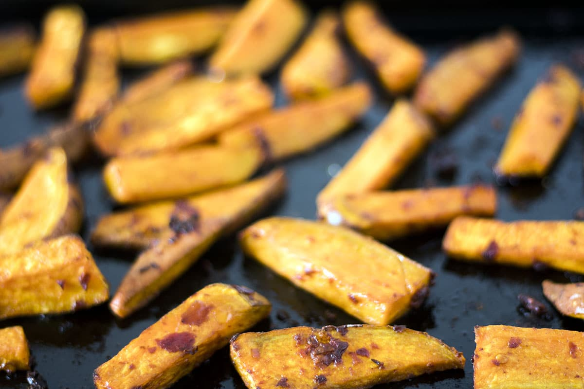 oven baked sweet potato wedges on baking tray