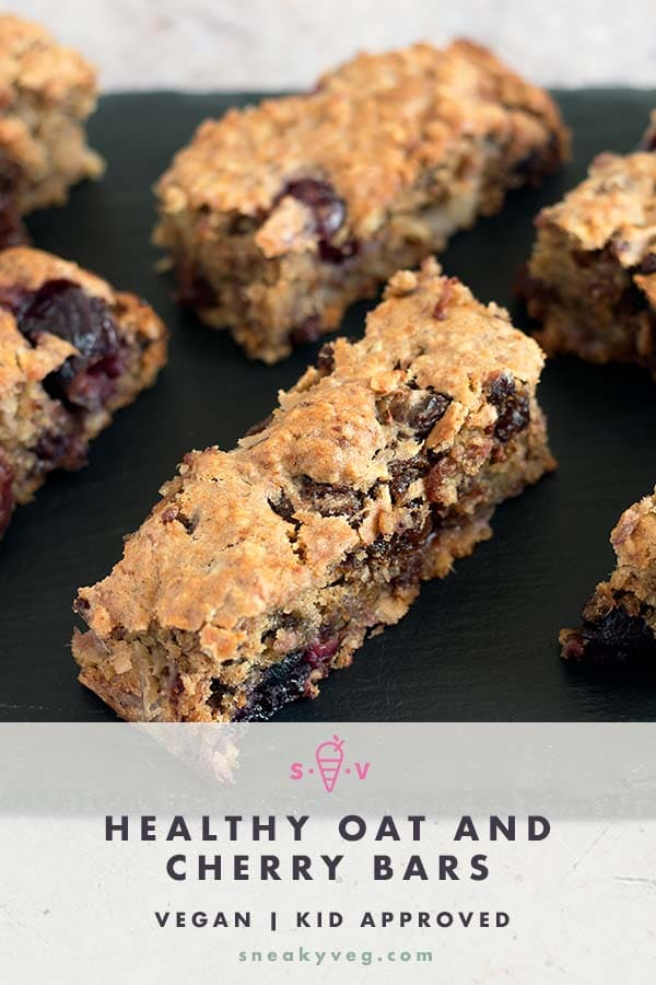 oat and cherry bars on black slate plate