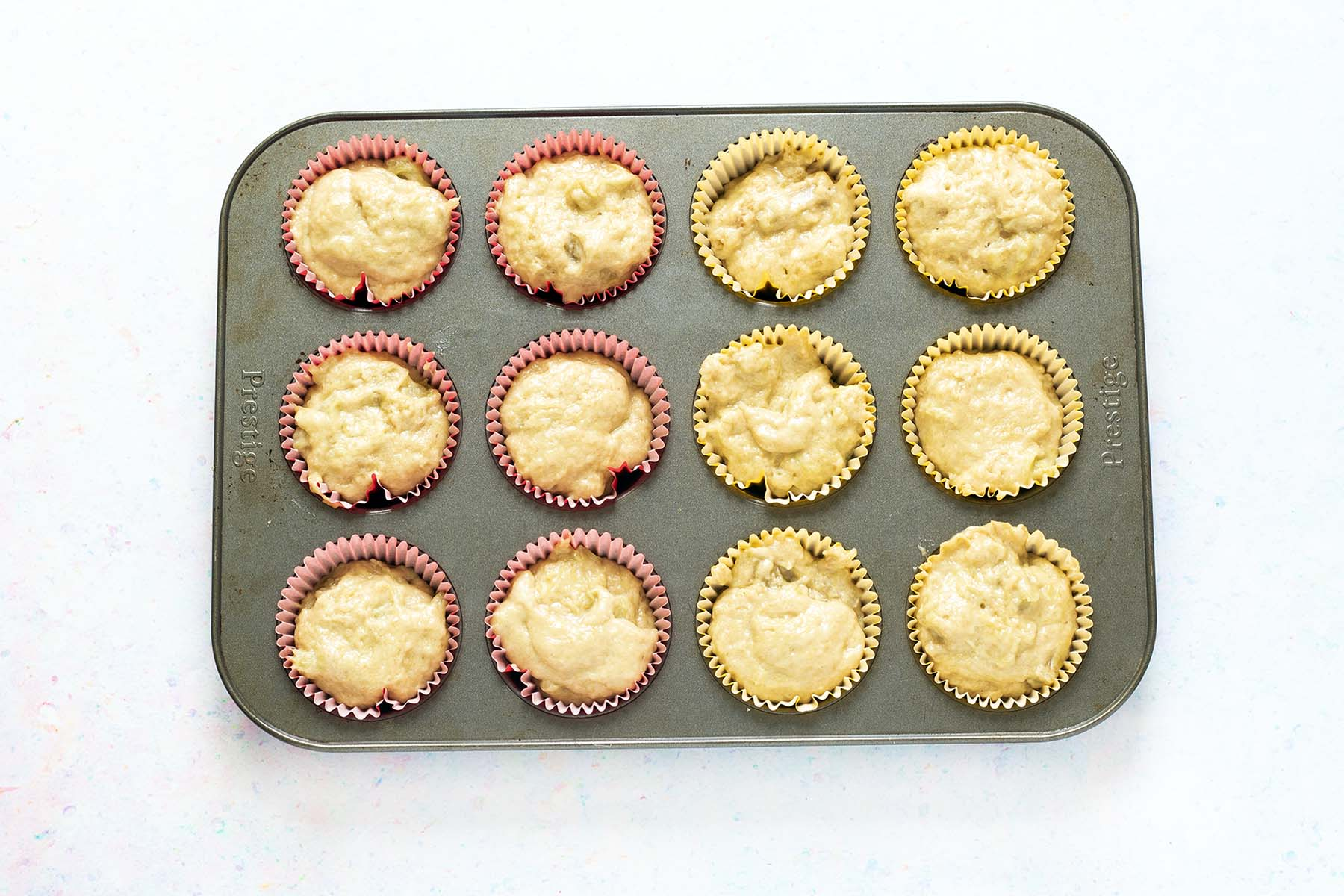 uncooked rhubarb muffins in tray