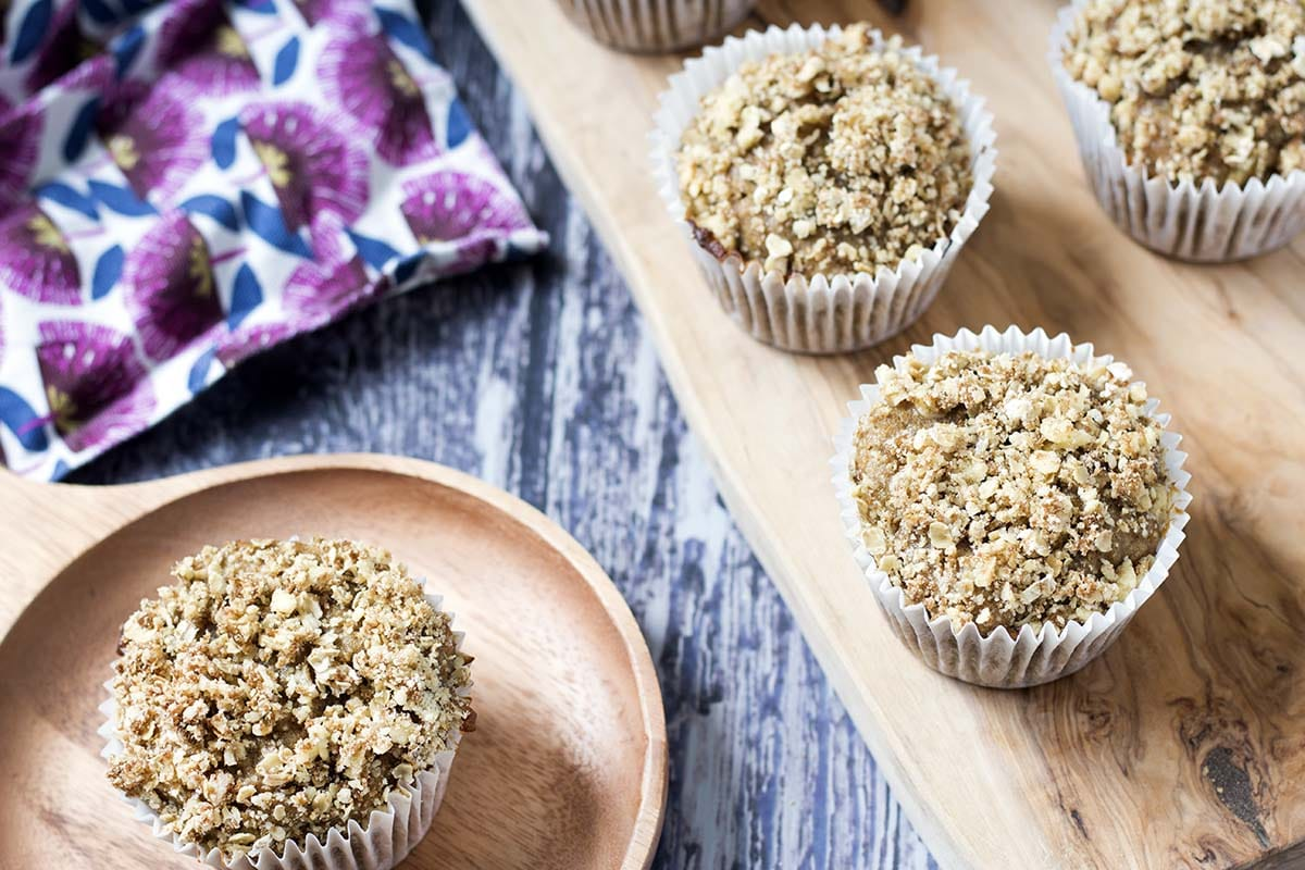 rhubarb muffins on wooden background