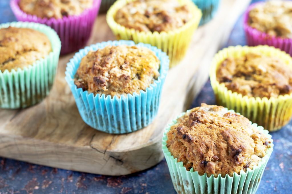 healthy banana muffins in bright cupcake cases