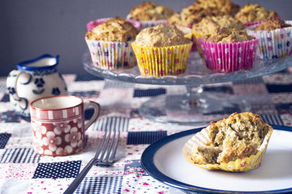 banana almond muffins on cake stand with colourful cases