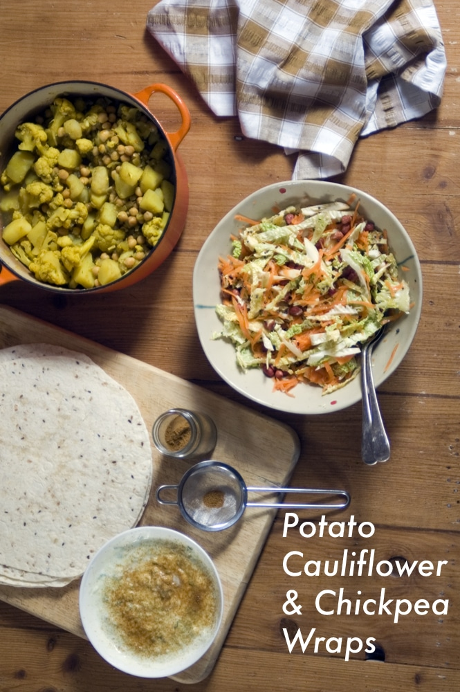 cauliflower, chickpea and potato curry wrap recipe with raita and crunchy cabbage relish