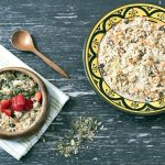 carrot cake over night oats in bowls with strawberries on wooden background