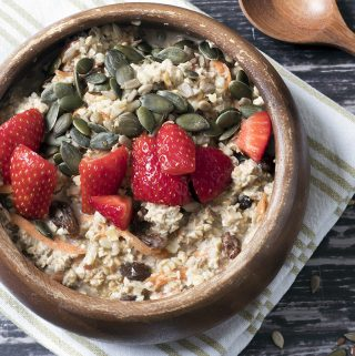 close up of carrot cake over night oats in bowls with strawberries