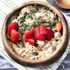 carrot cake overnight oats with strawberries and seeds