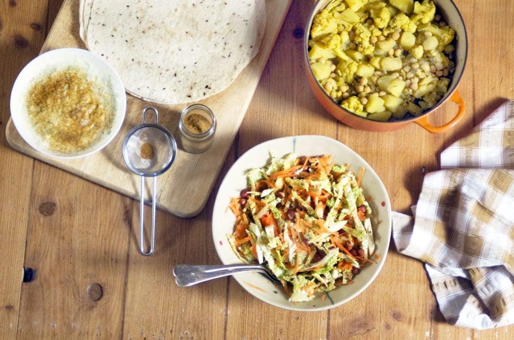 wraps, curry, raita and cabbage salad