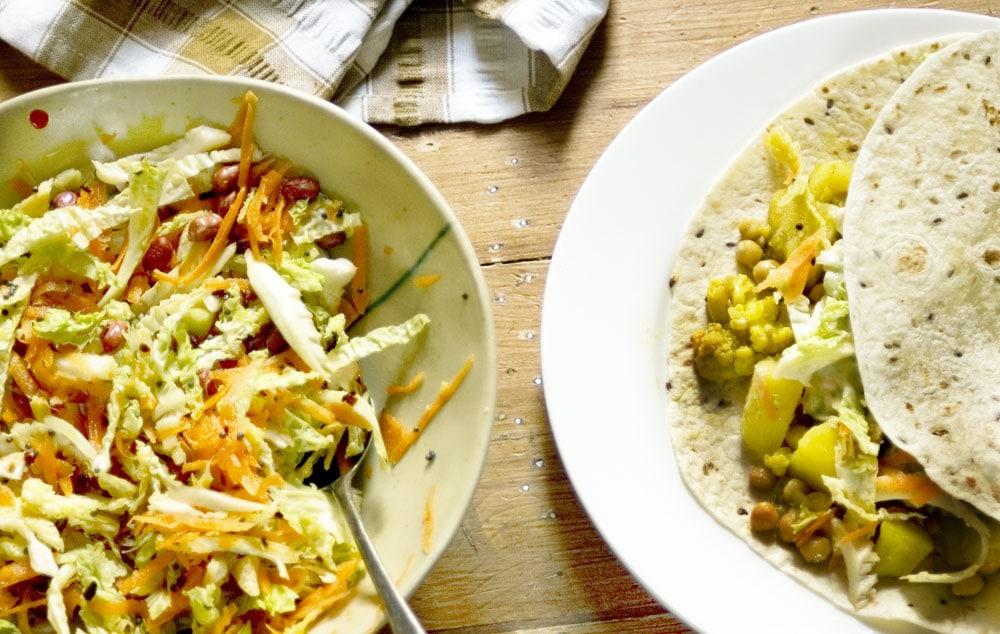 Veggie curry wraps on white plate