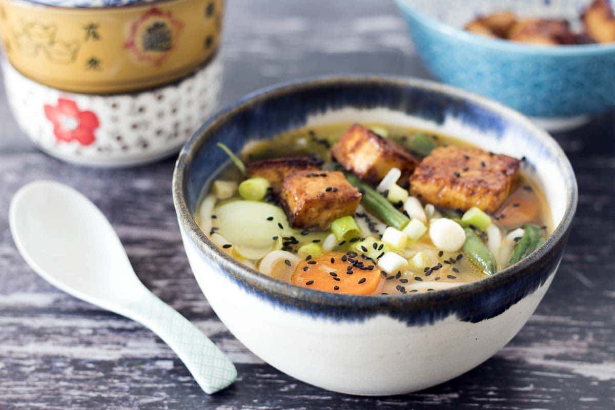 vegan udon noodle soup with tofu in bowl