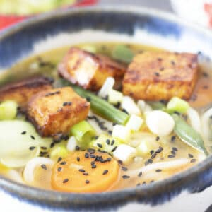 miso udon noodle soup with tofu in bowl