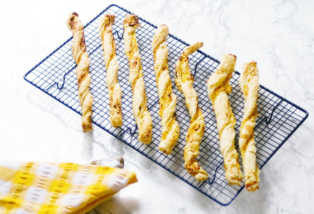 butternut squash cheese straws on cooling rack