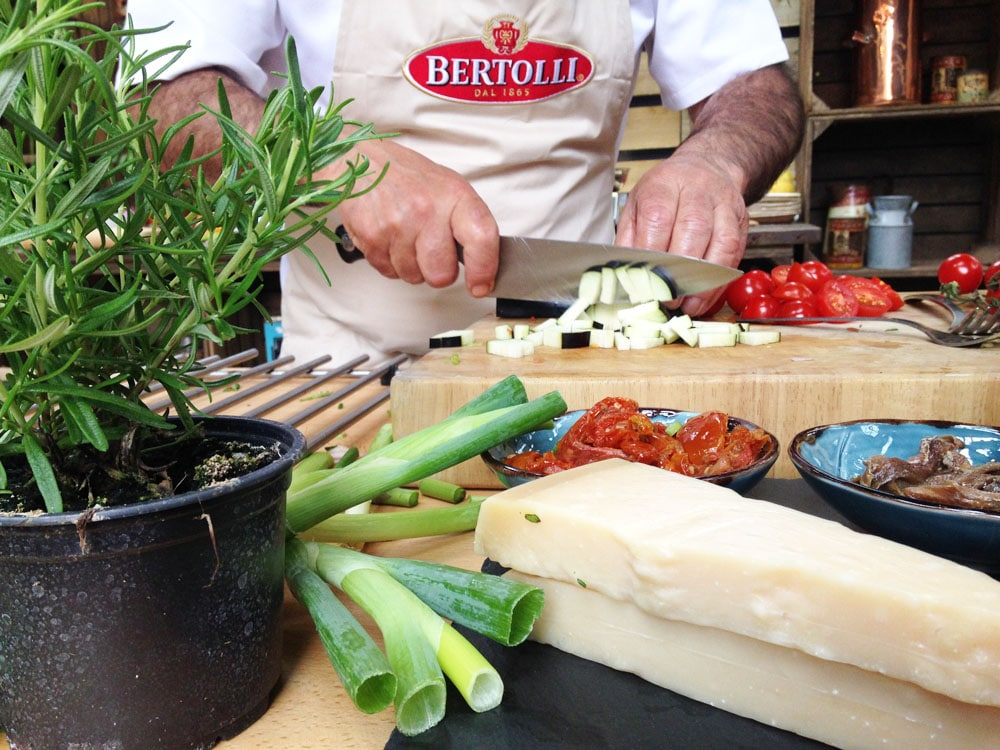 Gennaro Contaldo chopping veg at Bertolli with butter demo
