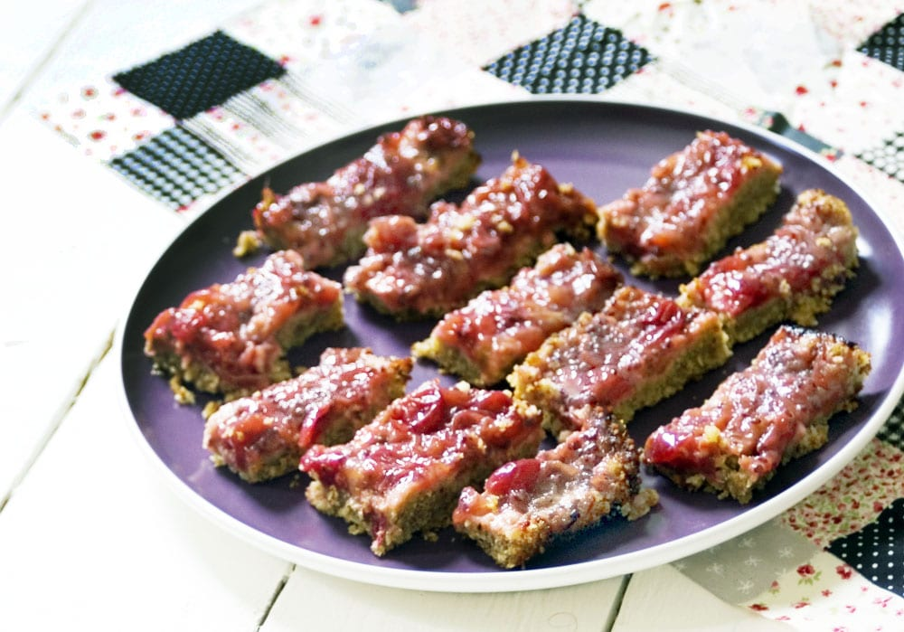 Gooseberry crumble bars on plate