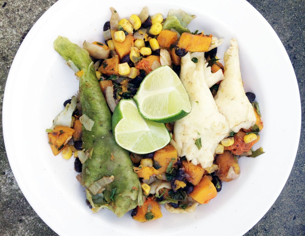 Pasta with black beans, squash and corn on white plate