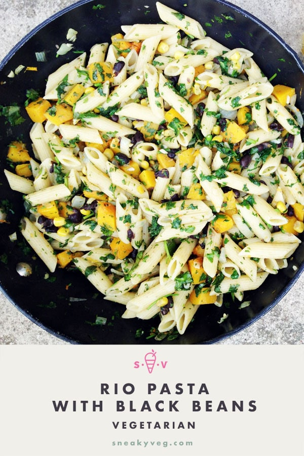 Pasta with black beans, squash and corn in pan