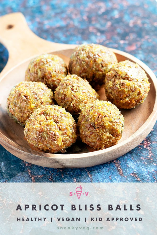 apricot bliss balls on wooden plate