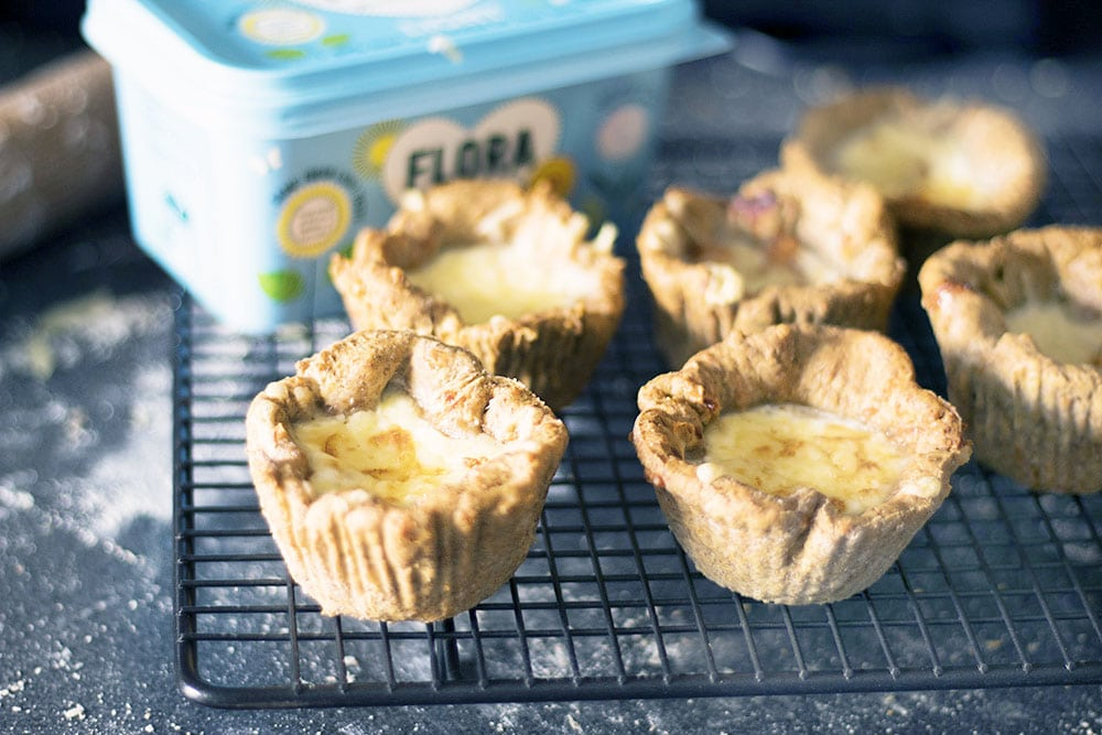 mini baked bean and cheese pies on cooling rack with flora tub in background