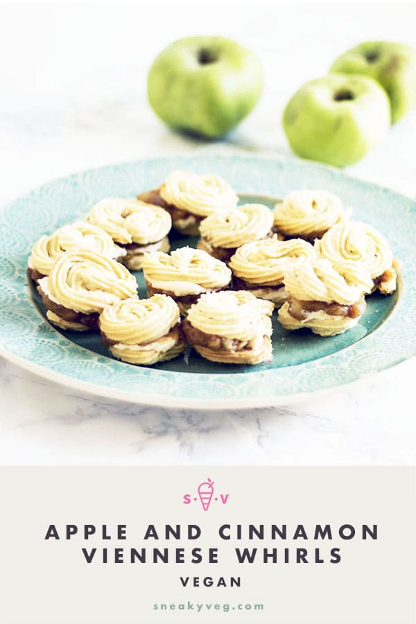 vegan apple and cinnamon viennese whirls on plate with apples in background