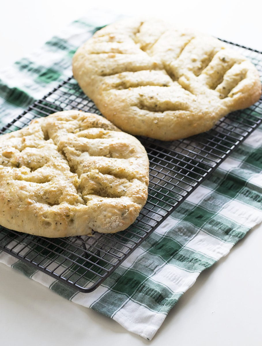herb fougasse on green and white cloth