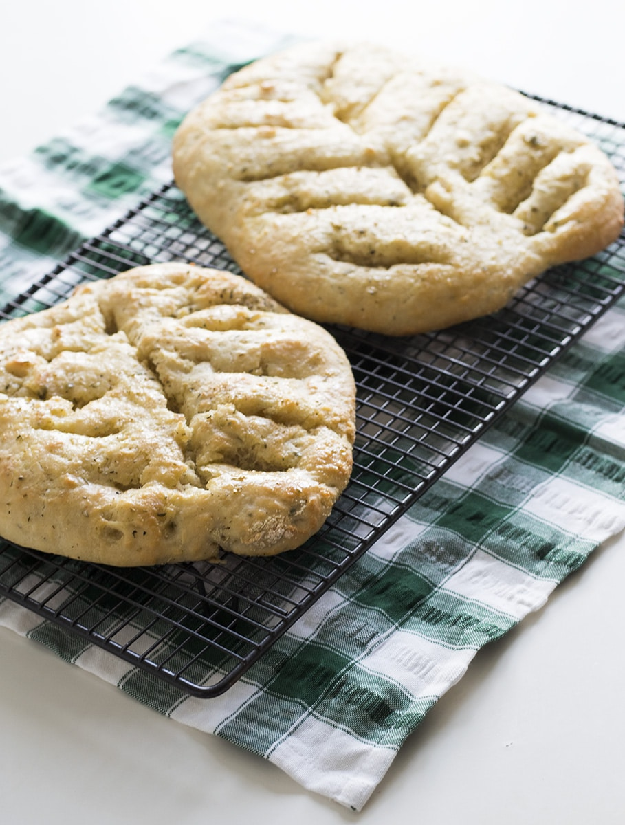 herb fougasse bread on cooling rack
