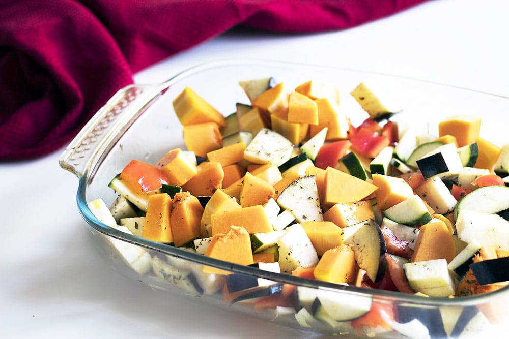chopped vegetables in roasting tin