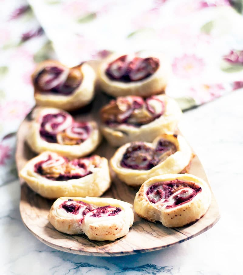 savoury palmiers with beetroot and goat's cheese on wooden plate
